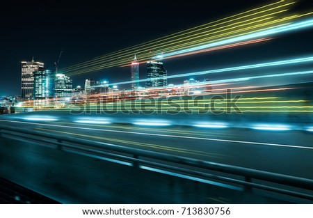 View from Side of flyover,blurred motion effect  with light trails and beautiful city skyline background . #713830756