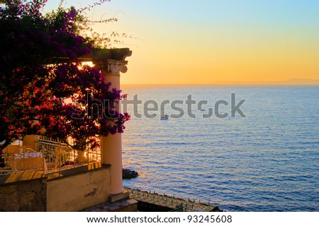View from Sorrento, Italy at dusk from a flower draped terrace