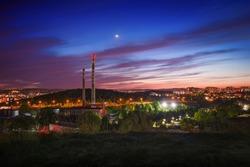 View from Stranska skala (Stránská skála in czech language) - the area of the incinerator of the city of Brno at dusk with Venus in the sky.