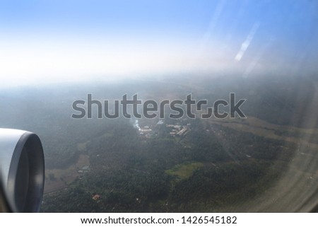 View from the airplane window on the river below. Tourist route to warm countries. The theme of the travel agency. Stock photo