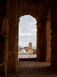 View from the arched window of the ancient Amphitheatre of El Jem to the modern city, Tunisia