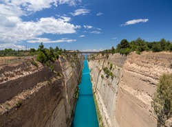 View from the bridge to the boats and yachts passing through the Corinth Canal from a sunny day on Peloponnese in Greece