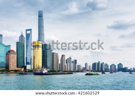 View from the Bund across the Huangpu River in Shanghai, China. The Shanghai Tower, the Shanghai World Financial Center, the Jin Mao Tower and other skyscrapers of downtown are visible at left.