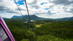 View from the Cable Car at Robin Hill, Truc Lam (Dalat, Vietnam)Aerial view for mountains, forest and lake.Amazing nature background.