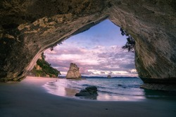 view from the cave at cathedral cove beach,coromandel,new zealand