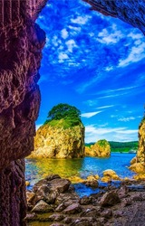 View from the cave to the sea rock. Sea rock cave. Mountain cave at sea rock