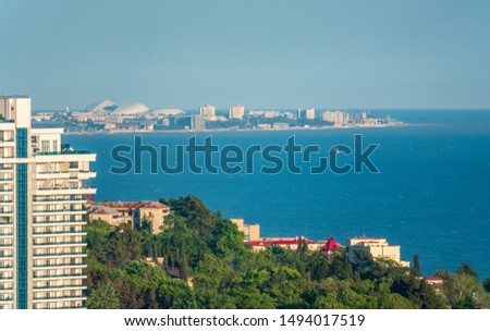 Photo of  View from the center of Sochi to the sea and Adler. Aerial view of a coastal town and sea.