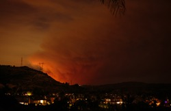 View from the city of Orange of the wild brush fire called the Canyon Fire near Corona, California on September 25, 2017.