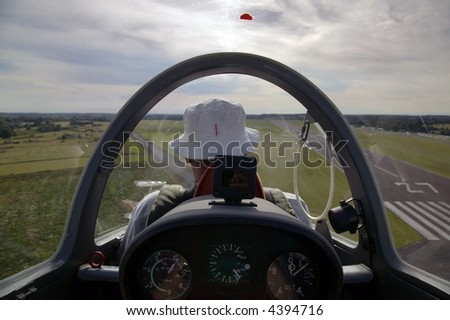 View from the cockpit of a glider about to land.