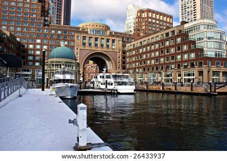 view from the dock at boston harbor and rowes wharf and skyscraper buildings in boston massachusetts