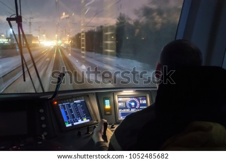 View from the driver's cab of an electric train, a night voyage on a railway