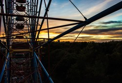 View from the ferris wheel at sunset. Ride on a ferris wheel.