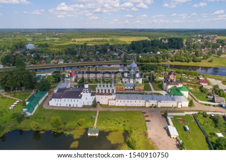 View from the heights of the temples of the Tikhvin Mother of God Assumption Monastery on a warm July July (aerial photography). Leningrad region, Russia
