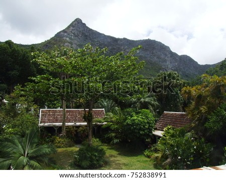 View from the Maison Eureka to a garden with two small creole houses, Mauritius