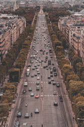 View from the monument Arc de Triomphe on the Champs-Elysées in Paris, in France, with a view on the road and some trees.