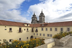 View from the Passageway between the Choristers' quarters and the Lodging House with the church in the background of the Monastery of Sao Martinho in Tibaes, Portugal