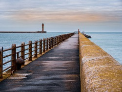 View from the pier towards Lighthouse guarding harbour entrance