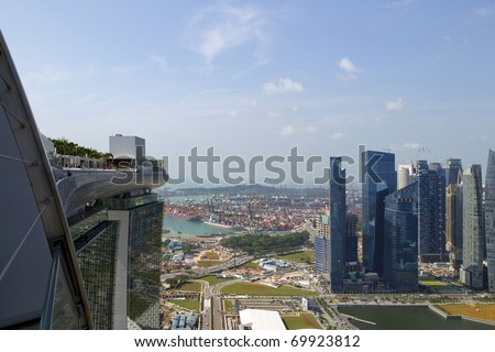 View from the roof top of new Marina Bay Sands hotel over shipyards and new business district, Singapore
