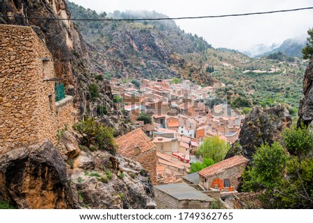 View from the roofs of the old and tourist town of Albacete Ayna internationally known with its green valley in the background Stok fotoğraf ©