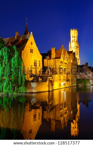 View from the Rozenhoedkaai of the Old Town of Bruges at dusk