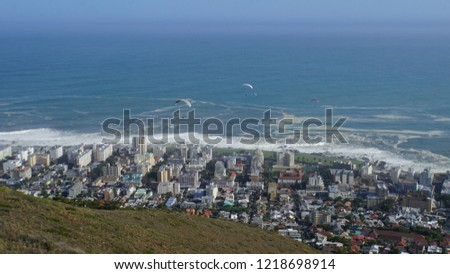 View from the Signal Hill on Cape Town, three paraglider airman  and the Atlantic coast
