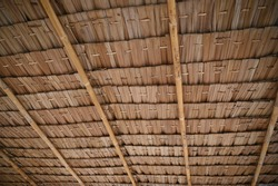 View from the southern side of a traditional thatched roof in a rural village. That thatched roof can be sunproof and rainproof. And good ventilation Background of hay or old hay