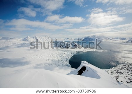 View from the top of mountains - Arctic landscape, glaciers and Arctic Ocean