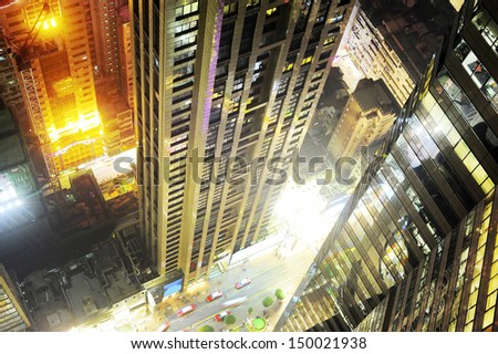 View from the top of skyscraper to Hong Kong city center street at night