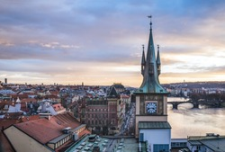 View from the top of the Charles bridge tower over the old town center of Prague at the sunset time in winter