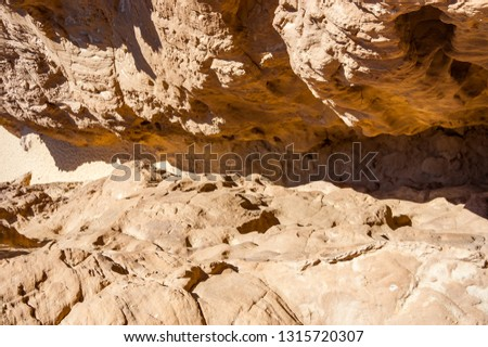 View from the top of the cliff on ravine between the rocks in Timna National Park in Israel