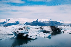 view from the top of the glaciers and the blue ice lagoon in iceland in summer on a sunny day