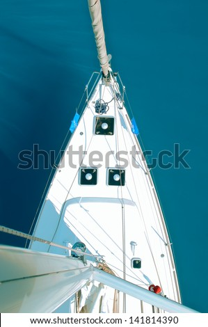 view from the top on a sailing yacht on a sea background