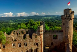 view from the tower to the ruins of Auerbach castle against the sky and clouds.