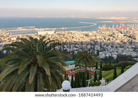 View from the upper terrace of the Bahai Garden to a part of the Bahai Garden, the downtown, the seaport and the Mediterranean Sea in Haifa in northern Israel