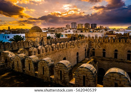 View from the walls of the fortress of Ribat of Sousse in Tunisia. Medieval architecture in sunset light. #562040539