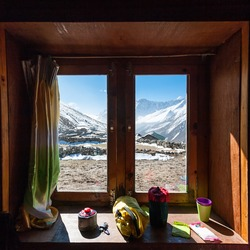 View from the window in high mountain lodge on the way to Renjo La pass in Everest region, Nepal