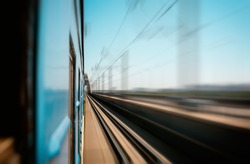view from the window of a train in motion