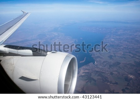 View from the window of the airplane flying over the river Dnieper