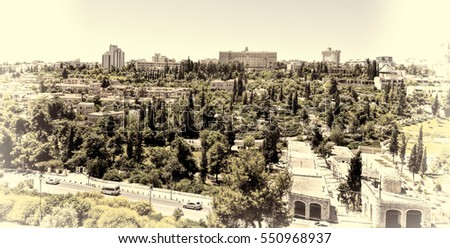 View from top of ancient walls surrounding Old City in Jerusalem. View on the landmarks of Jerusalem Old City. Vintage Style Toned Picture