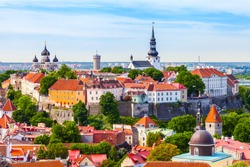 View from tower of Saint Olaf Church on old city of Tallinn and roofs of old houses. Tallinn, Estonia.
