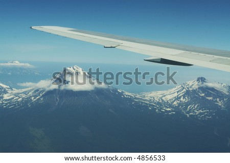 View in aircrafts window on Kamchatkian volcano