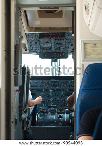 view in the cockpit of a small commercial airplane - stock photo