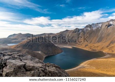 View inside of Volcano Nevado de Toluca National park with lakes inside the crater in Mexico in the morning blue sky - landscape near of Mexico City - Xinantecatl