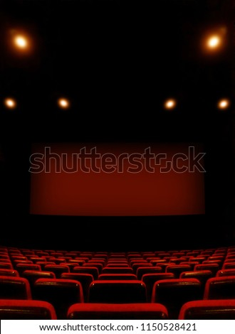 View inside the cinema on the screen and seats before the movie starts #1150528421