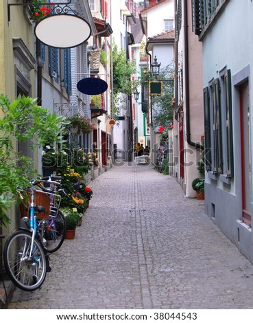 View into the old cobble stone alley Predigerstrasse in Zurich in Switzerland