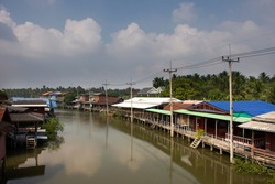 View landscape of Amphawa river and cityscape of Amphawa town and life thai people in amphawa floating market in weekday at Samutsongkhram city in Samut Songkhram, Thailand