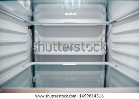 View Looking Inside Empty Refrigerator With Closed Door