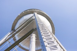 View looking up at a metal water tower