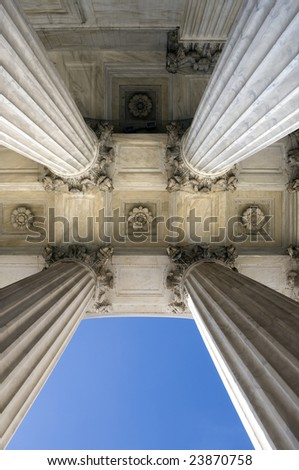 View looking up at the columns of the United States Supreme Court in Washington DC