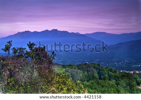 View looking west at sunrise from the Ojai Valley Rotary monument on California Highway 150